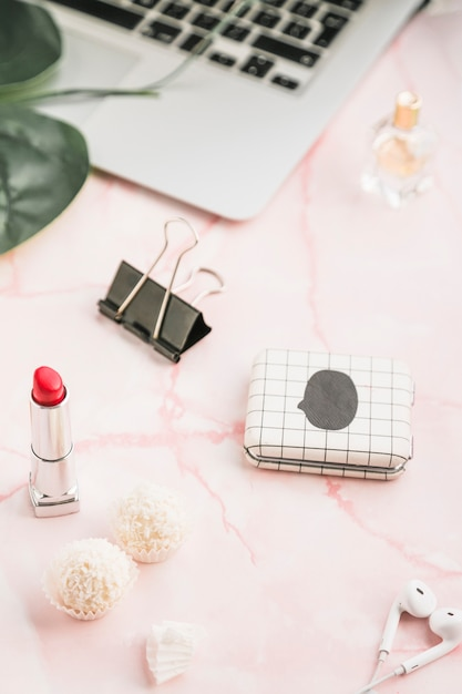 Office desktop with a lipstick Free Photo