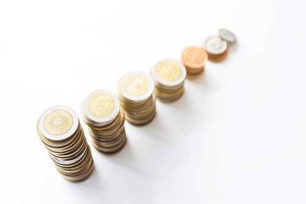 Office desktop with stacked coins Free Photo