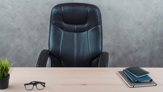 Office desktop with a swivel chair Free Photo