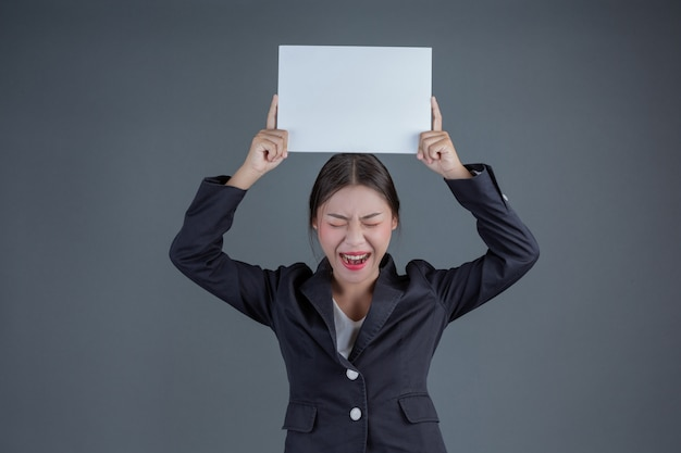 Office girl holding a white blank board Free Photo