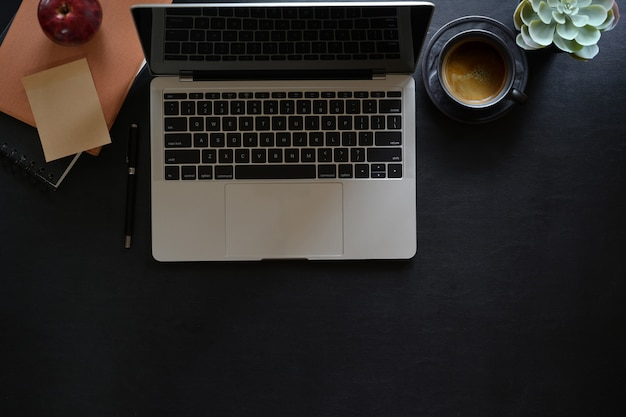 Office leather workspace with laptop and copy space Premium Photo