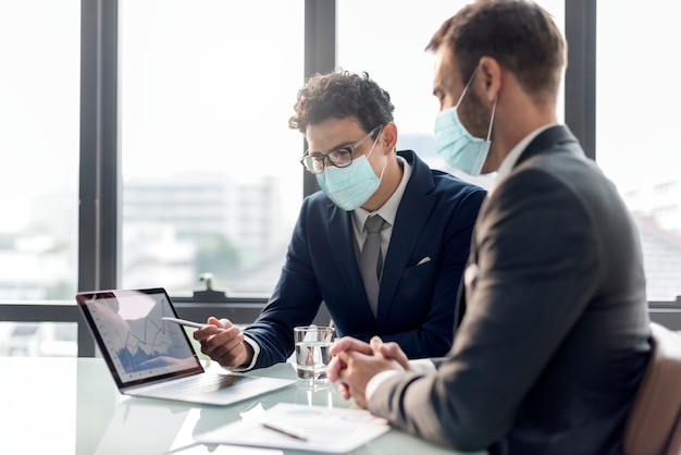 Office in new normal, men wearing medical mask covid 19 Free Photo