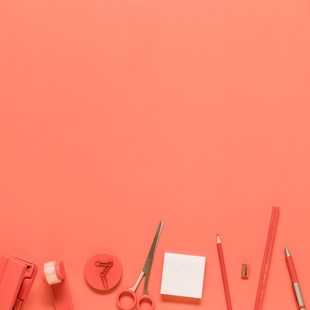 Office stationery on red background Free Photo