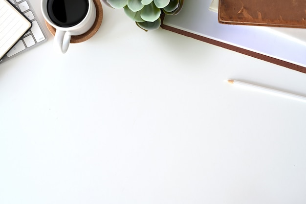 Office supplies at the white desk and copy space Premium Photo