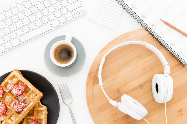 Office tools and waffles on desk Free Photo
