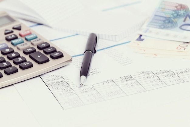Office with documents and money accounts Free Photo