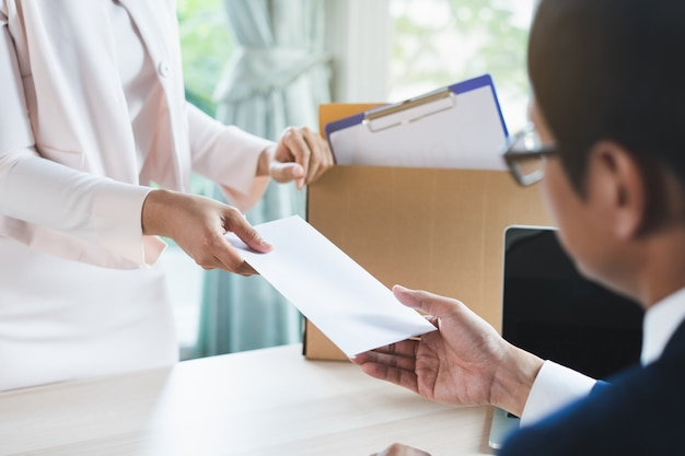 Office worker sending resignation letter to manager. Premium Photo