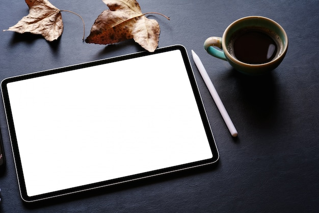 Office workspace with mockup blank screen tablet Premium Photo
