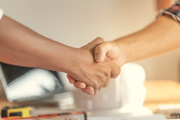Officer teamwork is happy and shake hands to celebrate in success of finish in job planning. Premium Photo