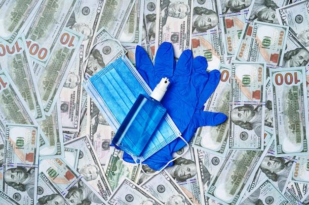 Ofusドル紙幣の保護医療マスク、手袋、消毒剤 Premium写真