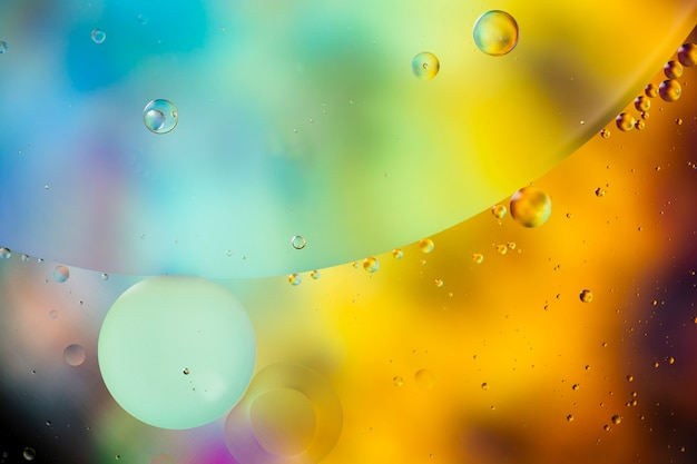 Oil drops in water abstract psychedelic pattern image Free Photo