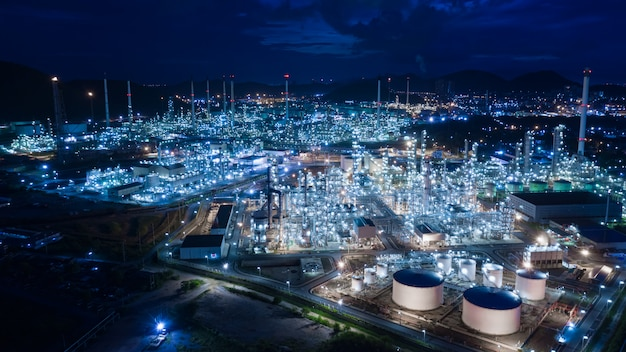 Oil and gas refinery industry and commercial storage at night aerial view Premium Photo
