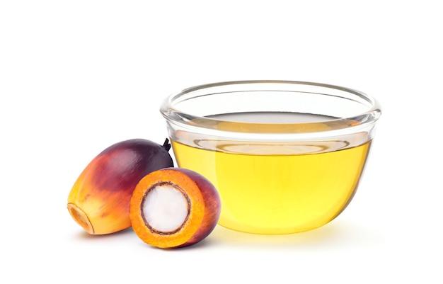 Семена масличной пальмы с растительным пальмовым маслом в стеклянной миске Premium Фотографии