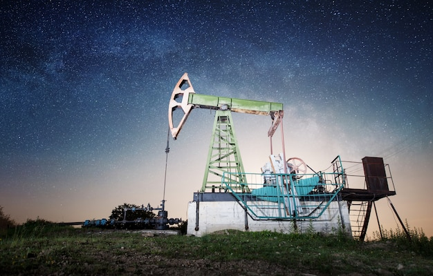 Oil pump on the oil field in the night Premium Photo