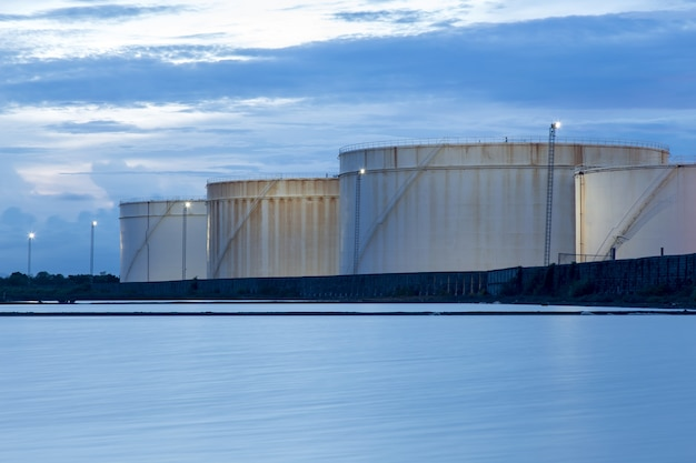 Oil storage tanks with blue sky and clouds Photo | Premium