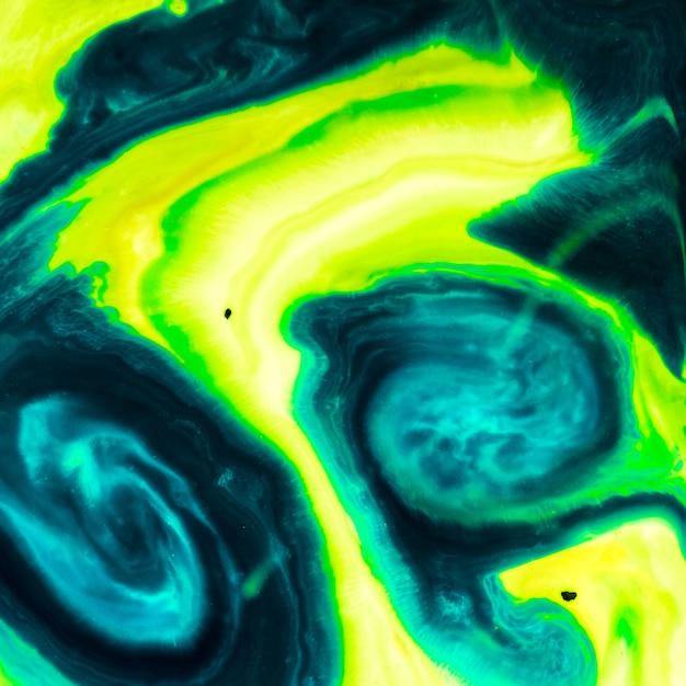 緑のグラデーショントーンの油性テクスチャ 無料写真