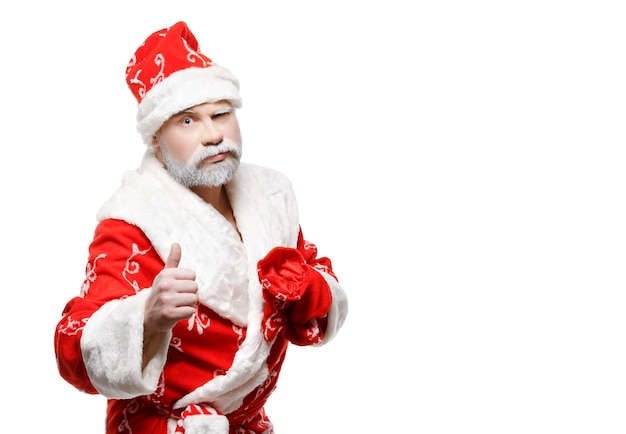 サンタクロースは、okサイン、白を示しています Premium写真