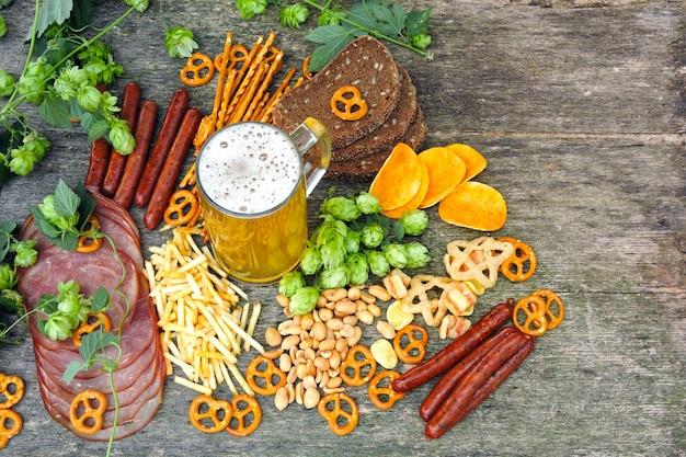 Oktober fest. glass of beer and beer snacks. Premium Photo