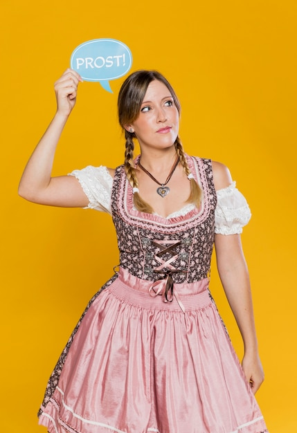 Oktoberfest young lady holding sign Free Photo