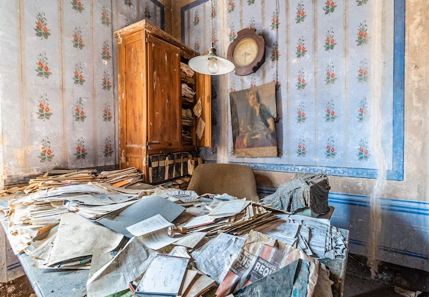 Old abandoned office with many documents Premium Photo