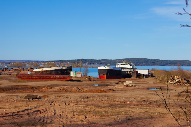 Old, abandoned ships in the port Premium Photo