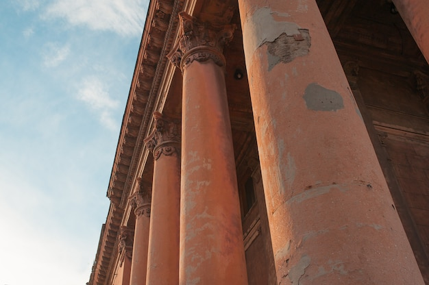 Old architectural columns on the sky Premium Photo