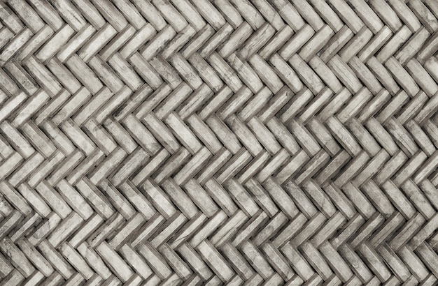 Old bamboo weaving pattern, woven rattan mat texture background. Premium Photo