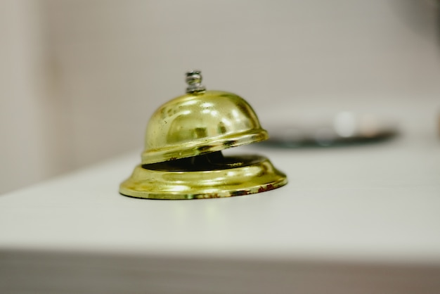 Old bell to call the bellman in a hotel, service bell hotel golden. Premium Photo