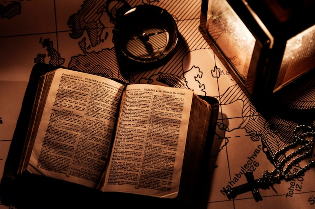 An old bible on a wooden table Free Photo