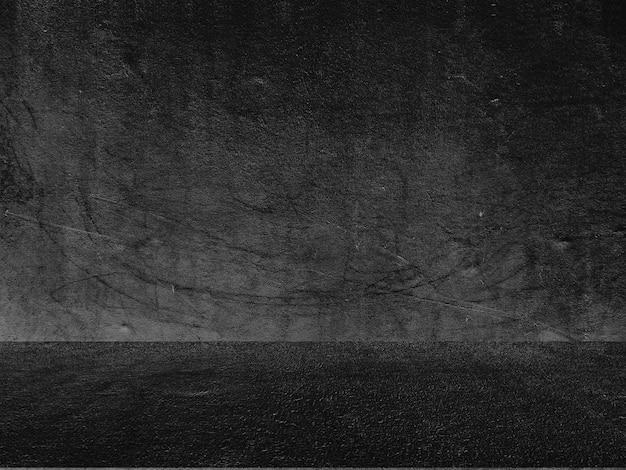 Old black background. grunge texture. dark wallpaper. blackboard chalkboard concrete. Free Photo