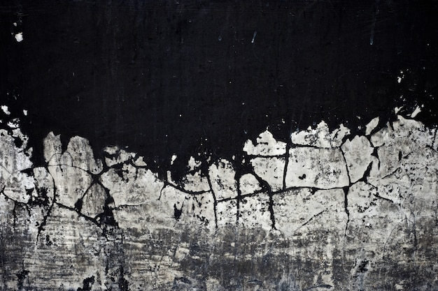 Old black paint texture peeling off concrete wall background Premium Photo
