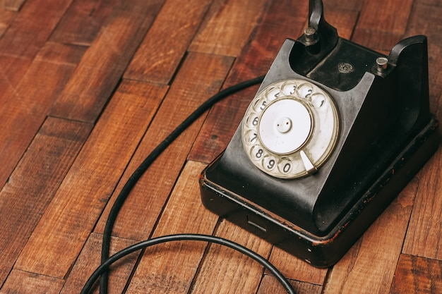 Old black telephone on the floor Premium Photo