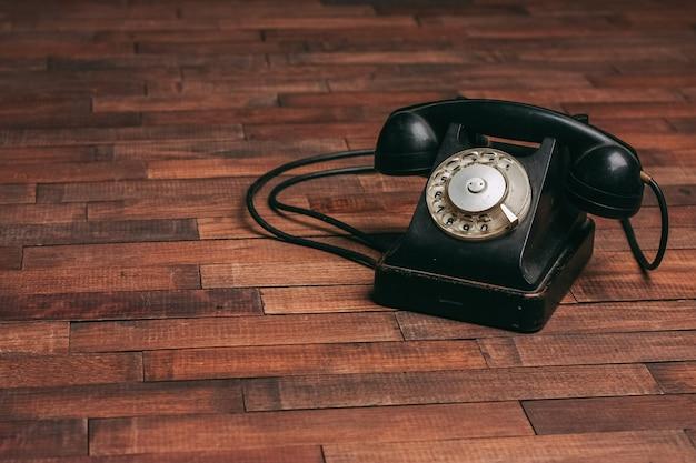 Old black telephone on the floor Premium Photo