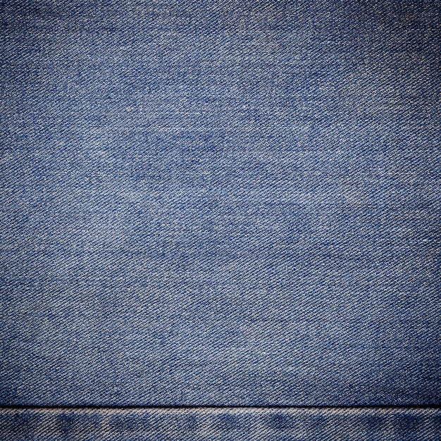 Old blue jeans background and texture close up Premium Photo