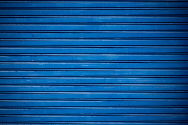 Old blue shuttered roll up metal door. Free Photo