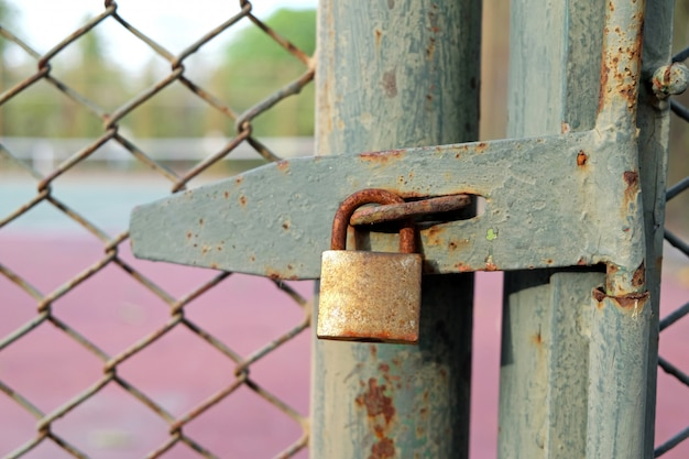 Old bolt and padlock on the door tennis court Premium Photo