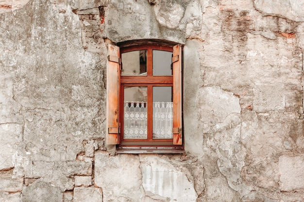 Old brick wall with wooden window Premium Photo