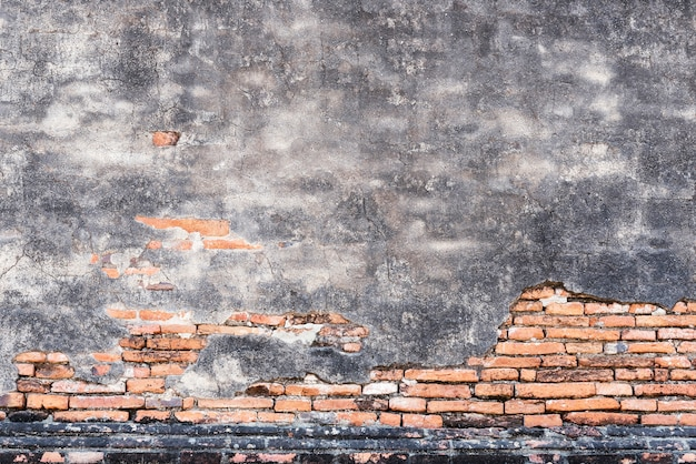 Old bricks pattern and cracked concrete wall for abstract background. Premium Photo