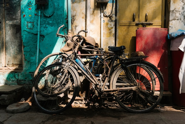 Old broken bicycles left outside of the house Free Photo