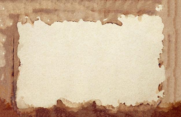 Старый фон гранж коричневой бумаги. абстрактная рамка жидкого кофе цвет текстуры. Premium Фотографии