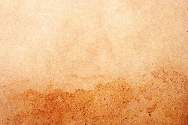 Старый фон гранж коричневой бумаги. абстрактная жидкая текстура цвета кофе. Premium Фотографии