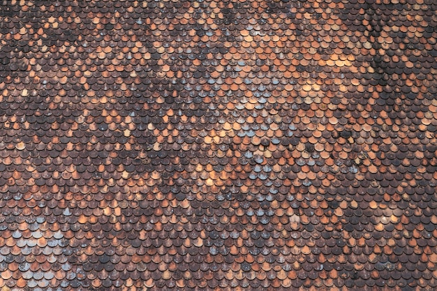 Old brown roof tile pattern background texture Free Photo