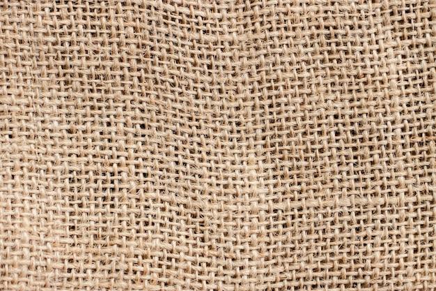 Старые коричневые текстура дерюги и предпосылка, делают по образцу абстрактную винтажную деталь ткани. Premium Фотографии