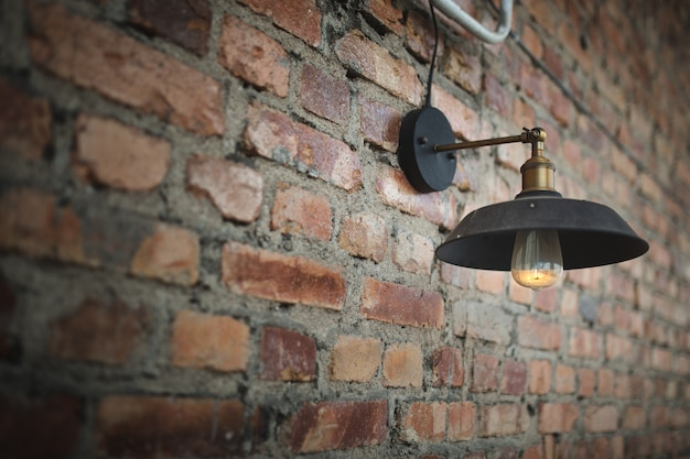 A old bulb on the old wall. Premium Photo