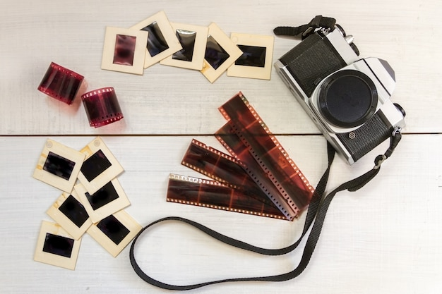 Old camera with negatives and slides photography Premium Photo