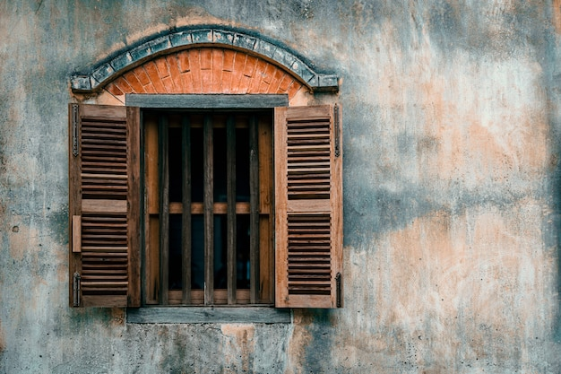 Old cement wall with wood window.. Premium Photo