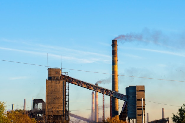 Old chemical plant from pipes smoke Premium Photo