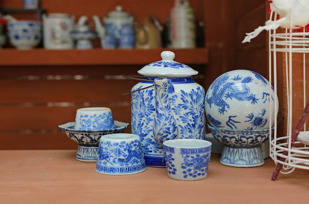 Old chinese porcelain teapot and teacup. Premium Photo