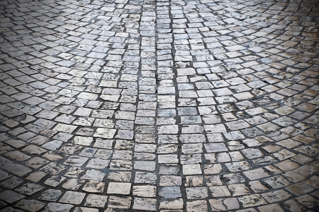 Old cobblestone street background texture dark vignette Free Photo