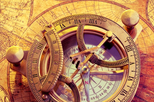 Old compass over ancient map Premium Photo